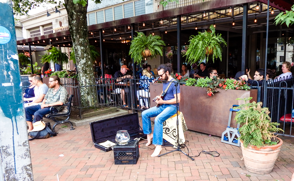 Guitarist entertaining the crowd in the square.